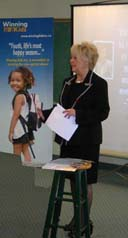 Diane Roblin-Lee Speaking at a Plan To Protect, Winning Kids Inc. Event